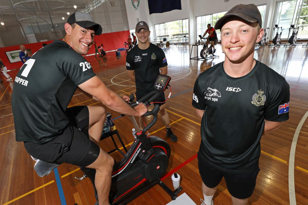 Sapper Harrison Chaffey, left, supported by Sappers Braith Wallis and Brandon Subloo during the 42 for 42 endurance fundraising event at Gallipoli Barracks, Enoggera. Photo: Corporal Jesse Kane