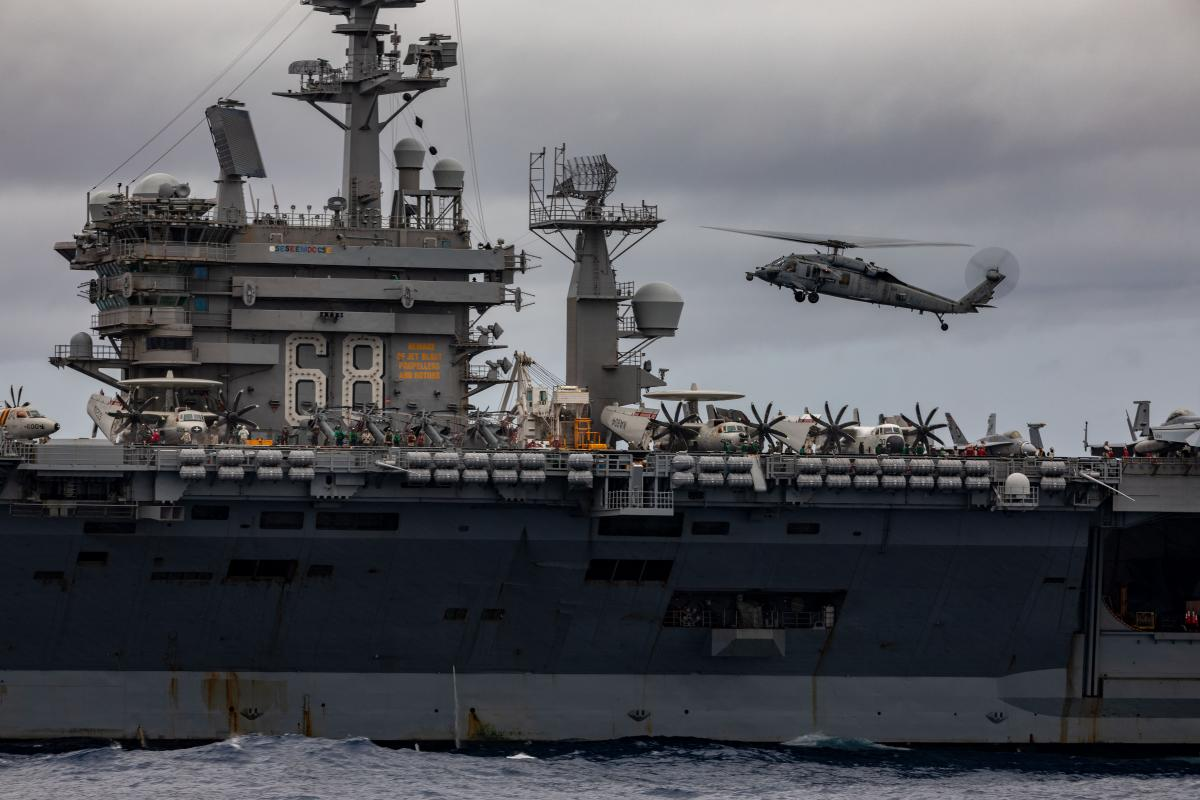 An MH-60S helicopter approaches USS Nimitz flight deck during a passage exercise with HMAS Ballarat in the Indian Ocean. Photo: Leading Seaman Shane Cameron