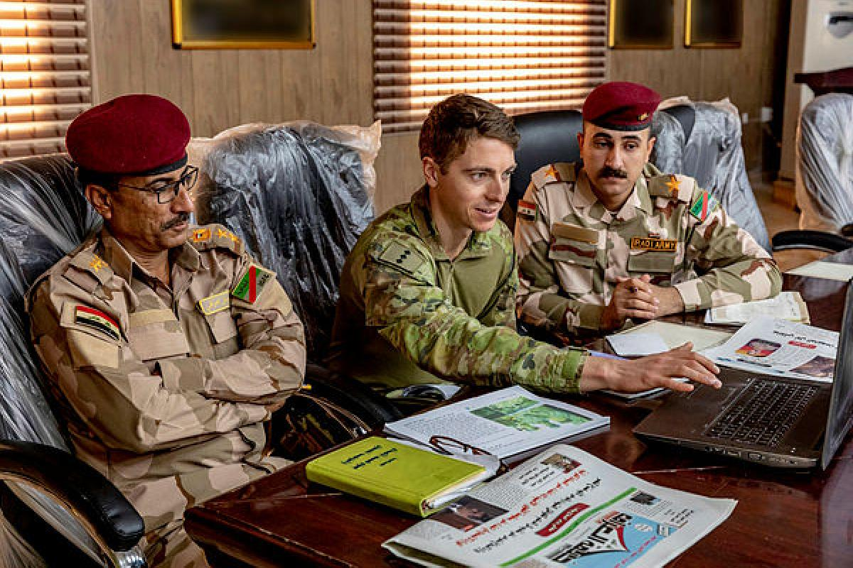 Australian Army officer, Captain Dean Benson,  delivers a public affairs lesson to Iraqi Security Forces officers at the Taji Military Complex, Iraq. Photo: Corporal Tamara Cummings