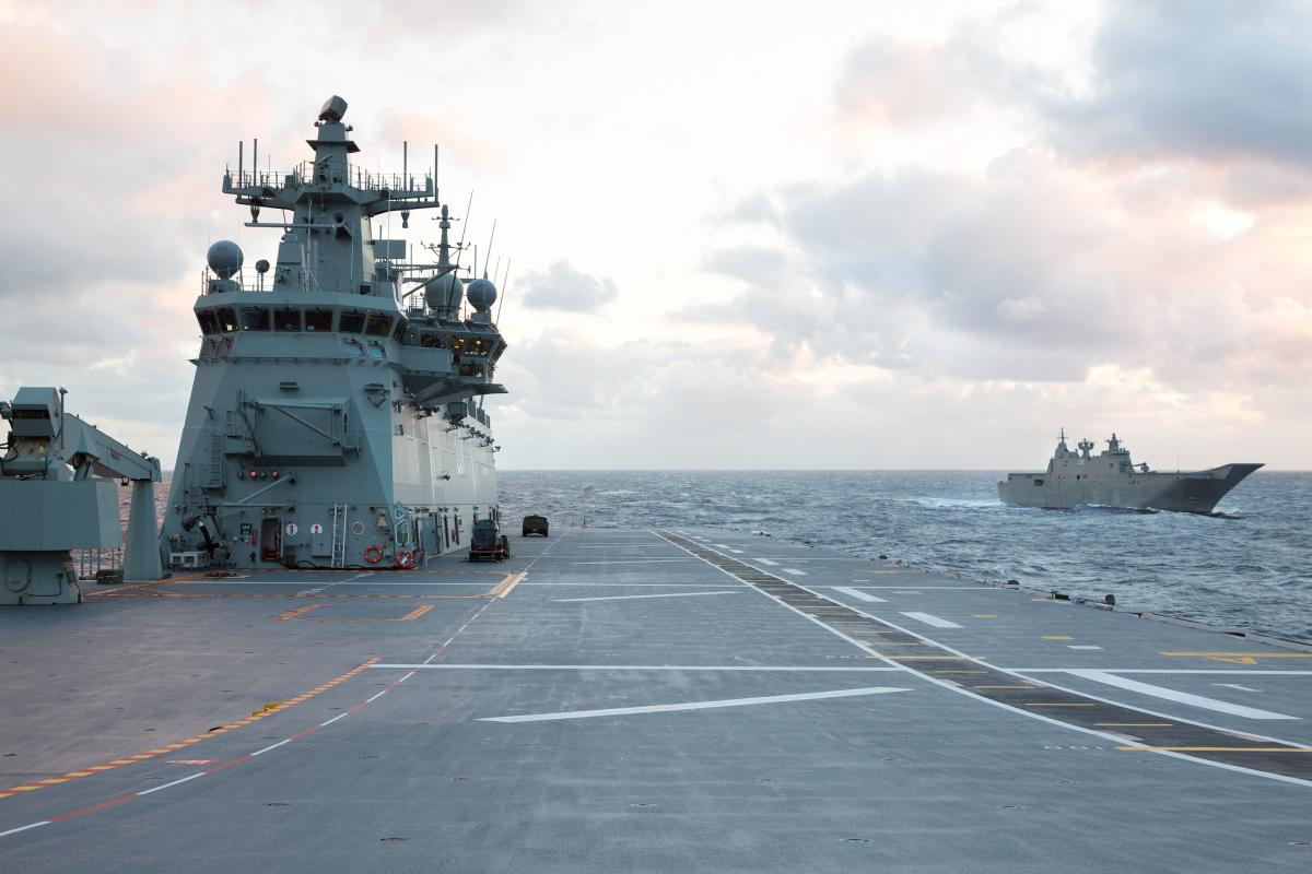 HMAS Adelaide and her sister ship HMAS Canberra sail in company through heavy seas in the East Australian Exercise Area off the coast of NSW. Photo: Leading Seaman Peter Thompson