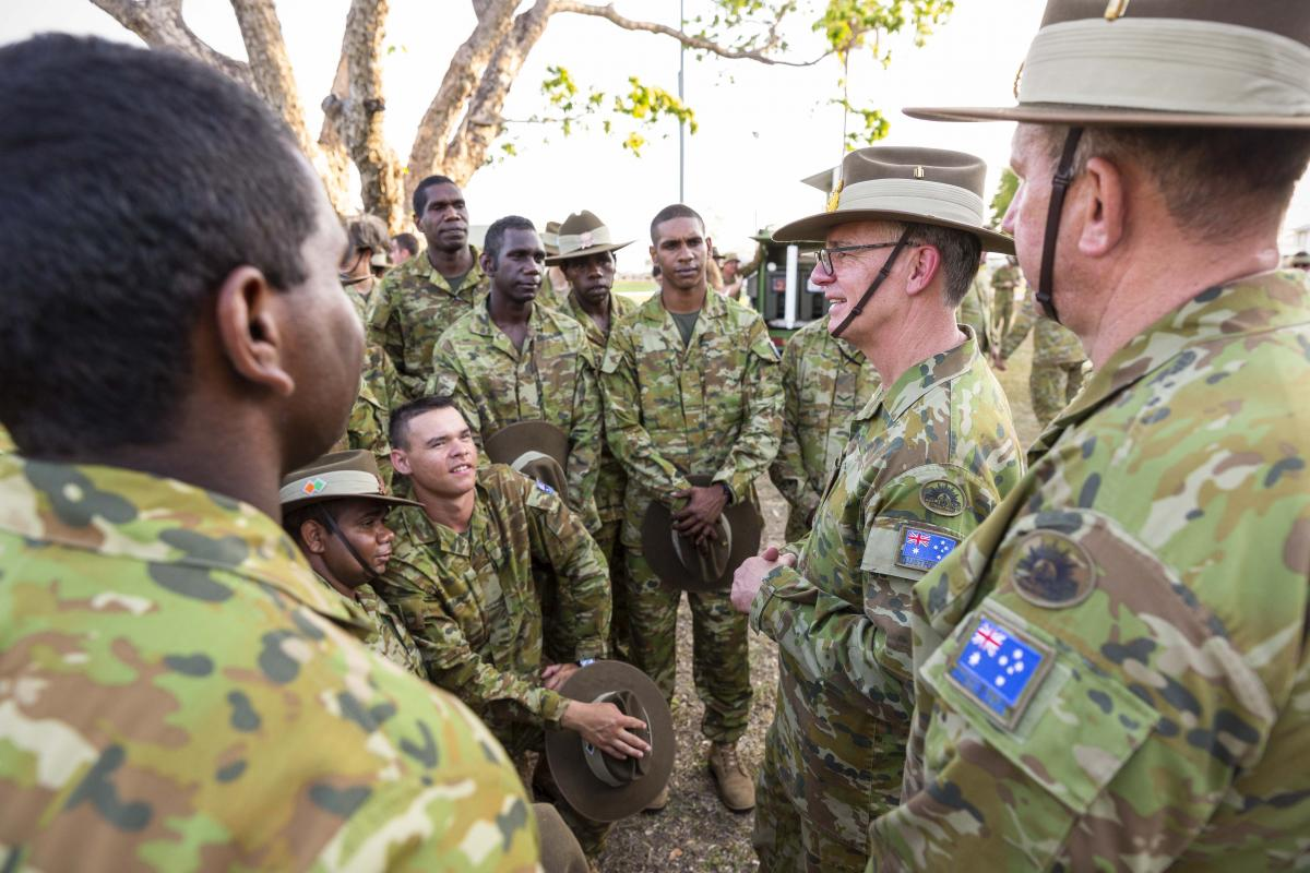 Chief of Army Lieutenant General Rick Burr talks to soldiers from the 51st Battalion, Far North Queensland Regiment and The Pilbara Regiment. Note: image was taken before social distancing requirements. Photo: Sergeant Sebastian Beurich