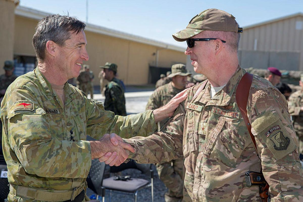 Brigadier John Shanahan (left) meets with Train, Advise, Assist Command - Air Commander Brigadier General Joel Carey after the transfer of authority.