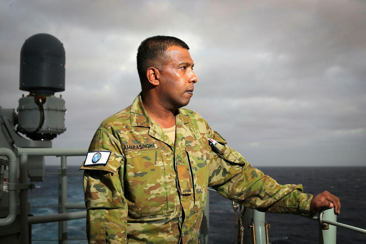Private Mick Amarasinghe stares across the Indian Ocean from the quarter deck while on board HMAS Canberra during Indo-Pacific Endeavour 2019.