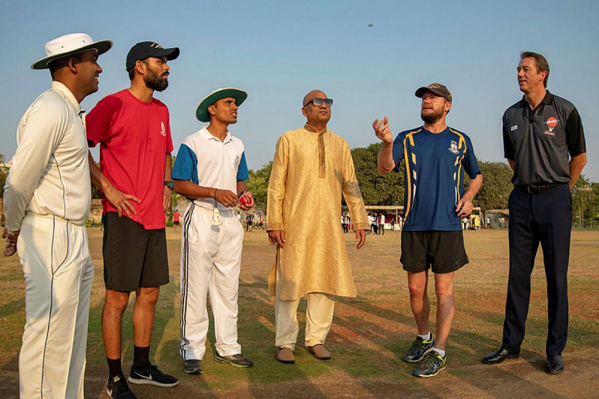 Glen McGrath, right, observes as the coin is tossed at the start of a friendly cricket match between combined Royal Australian Navy and Indian teams  at the Prince of Arcot cricket ground in Chennai, India. Photo: Christopher Szumlanski