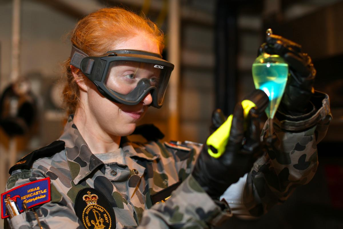 Leading Seaman Sarah Battenally conducts a sediment and water test on HMAS Newcastle's marine diesel fuel while on deployment.