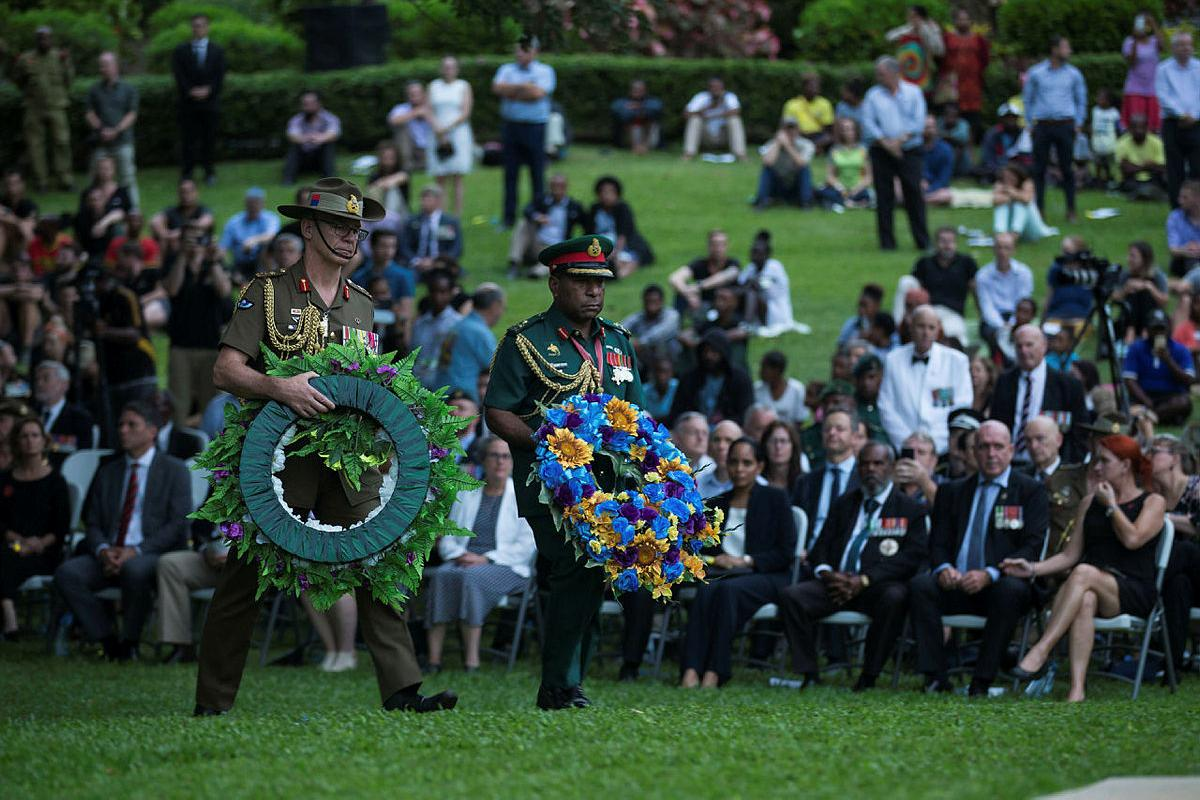 Chief of the Australian Army, Lieutenant General Rick Burr, and Chief of the Papua New Guinea Defence Force, Major General Gilbert Toropo, lay wreaths during the Anzac Day 2019 dawn service at the Bomana War Cemetary, PNG. Photo: Corporal Kyle Genner
