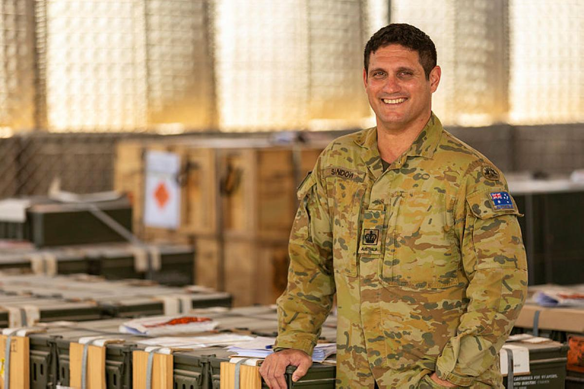 Warrant Officer Class Two Nathan Sandow checks the stock on hand at the explosive ordnance area.