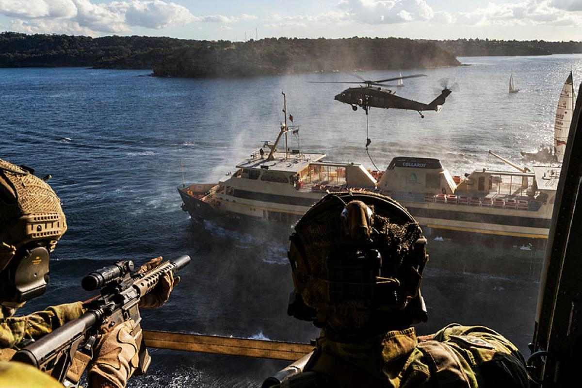 Soldiers from the 2nd Commando Regiment secure a Sydney ferry in Middle Harbour, New South Wales, during counter-terrorism training. Photo: Corporal Kyle Genner