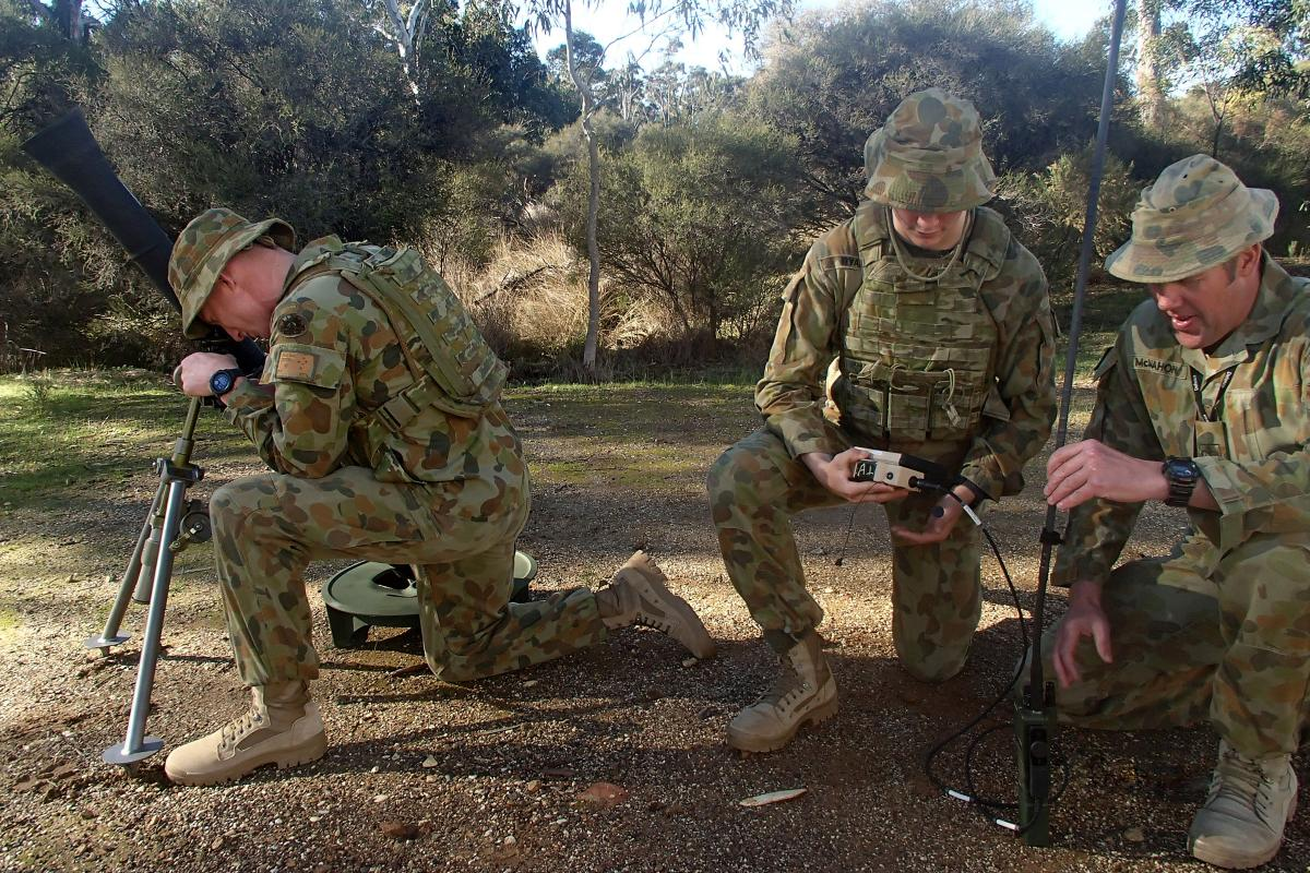 Mortar Warrant Officer at the School of Artillery, Warrant Officer Class Two Matthew McMahon, left, instructs soldiers in the operation of the M252A1 81mm mortar and the M32A1 ballistic computer.
