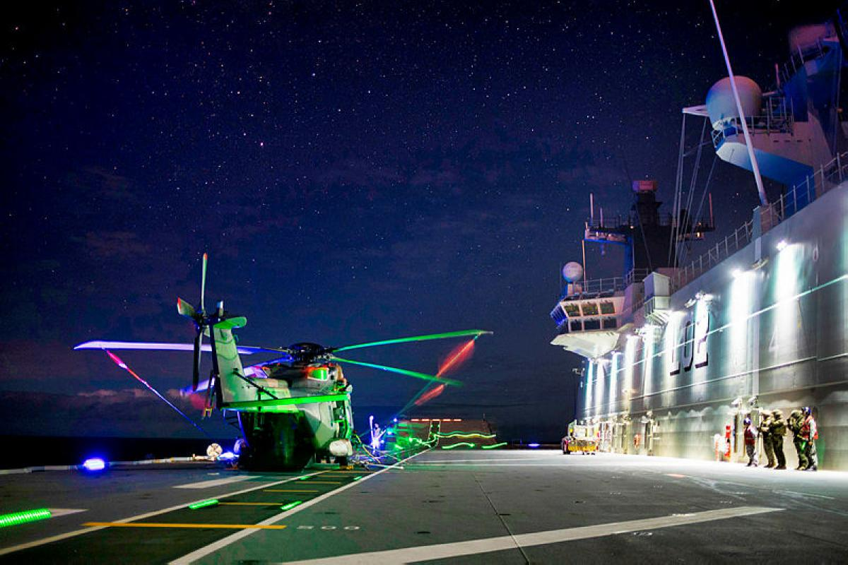 US Marines and Royal Marine Commandos practise loading drills at night onto a MRH90 helicopter on HMAS Canberra as part of Exercise Talisman Sabre 2019 in North Queensland. Photo: Leading Seaman Richard Cordell