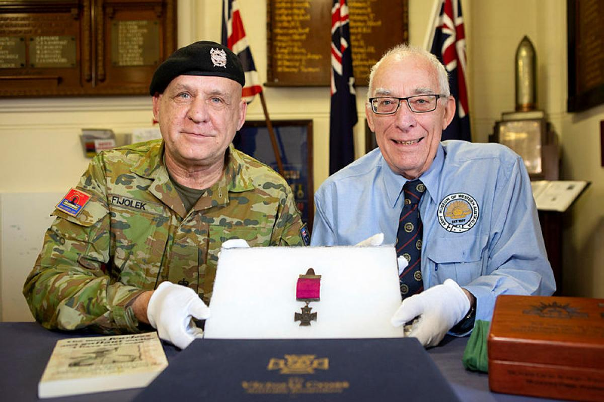 Australian Army Museum of Western Australia Manager Major Henry Fijolek, left, holds Sergeant Martin O'Meara's Victoria Cross medal along with the Museum Deputy Curator Richard Bennett at the museum in Fremantle. Photo: Chief Petty Officer Damian Pawlenko