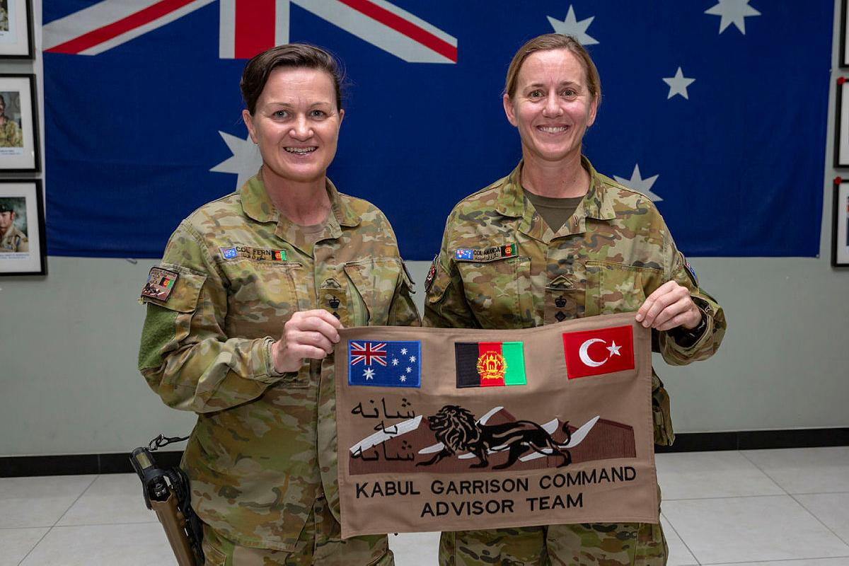 Kabul Garrison Command Adviser Team 5 commander Colonel Fern Thompson, left, and Kabul Garrison Command Advisor Team 6 commander Colonel Amanda Johnston at the transfer of authority ceremony at Camp Grant, Kabul. Photo:  Corporal Dan Pinhorn