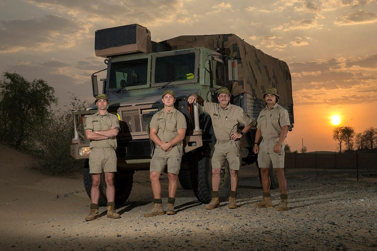 Lance Corporal Daniel Waller, Craftsman Samuel Jarvis, Sergeant Graeme Kennedy and Craftsman Joseph Green in front of the Australian Army Unimog they rebuilt from the ground up. Photo: Sergeant Kirk Peacock