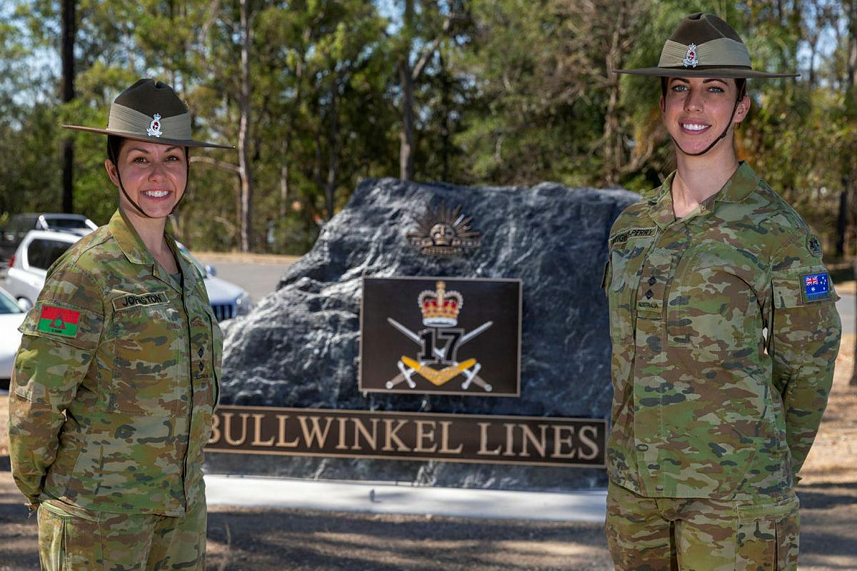 Nursing officers Lieutenants Kylie Johnston, left, and Celie Bright-Perry stand in front of the stone monument that marks the entrance to the 17th Brigade Bullwinkel Lines. Photo: Gunner Sagi Biderman
