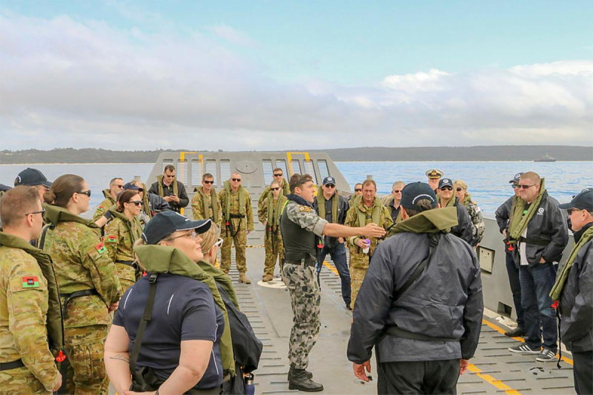 Exercise Boss Lift members and Army Reservists on board an LHD landing craft from HMAS Canberra for a demonstration of craft capabilities. Photo: Robin Hooper