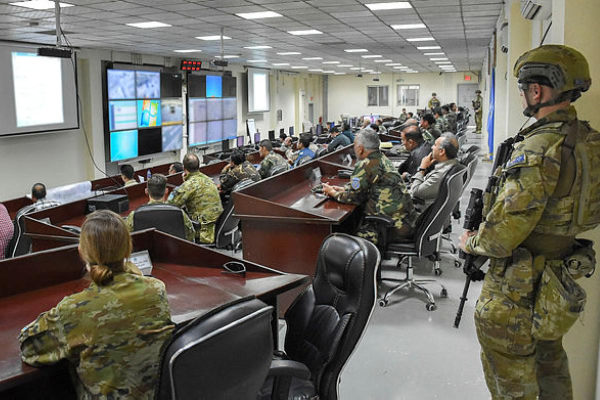 Australian advisers deployed to the Kabul Garrison Command participate in a planning brief alongside personnel from the Afghan National Defense and Security Forces during the presidential election.