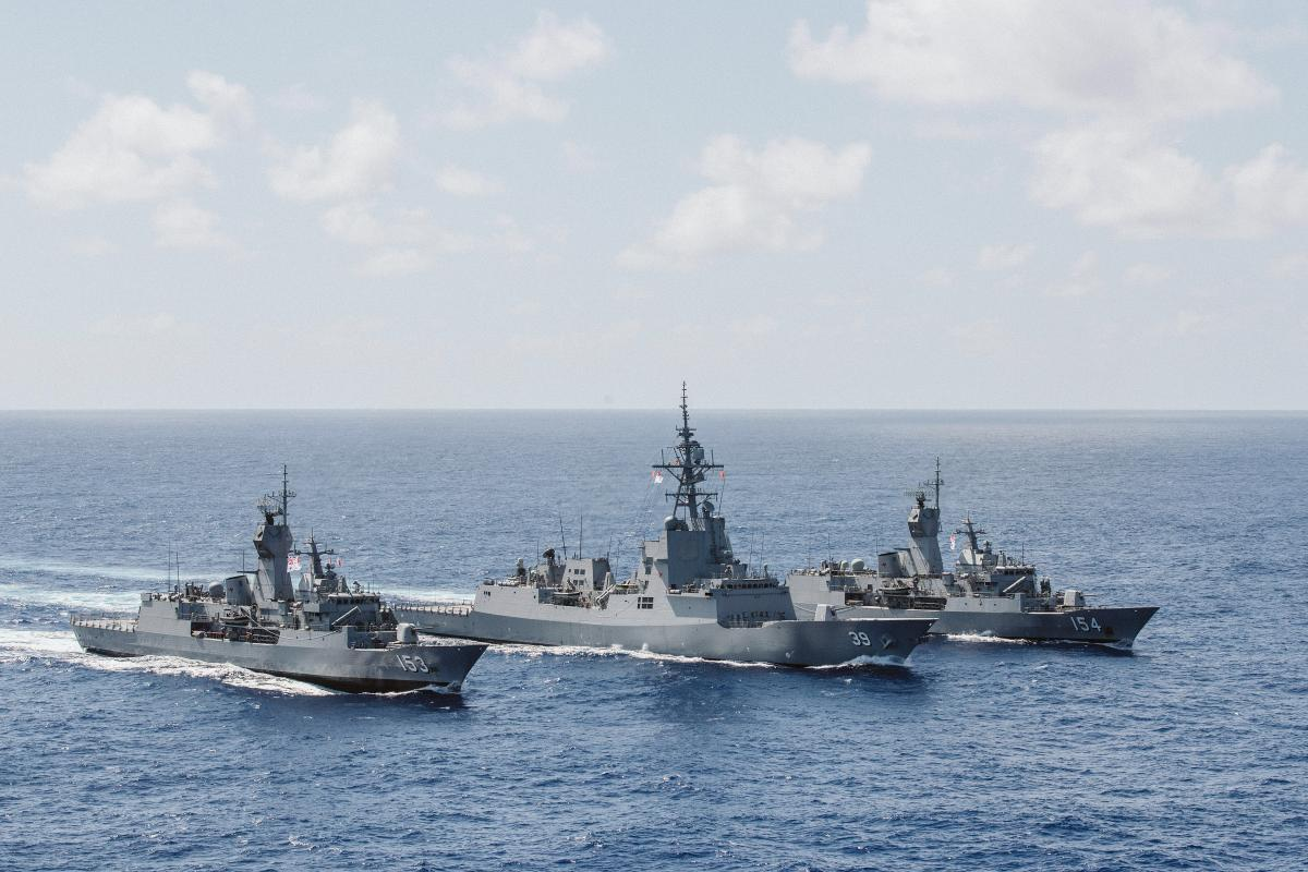 HMA Ships Hobart, Stuart and Parramatta conduct replenishment-at-sea manoeuvres during transit on the East Asia Deployment. Photo: Leading Seaman Tara Byrne