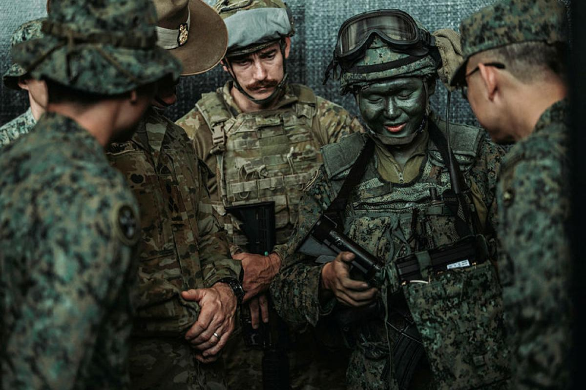 Singaporean soldiers demonstrate remote robot controls to Australian Army troops during an Exercise Matilda urban training package at Gallipoli Barracks, Brisbane. Photo: Private Jacob Hilton