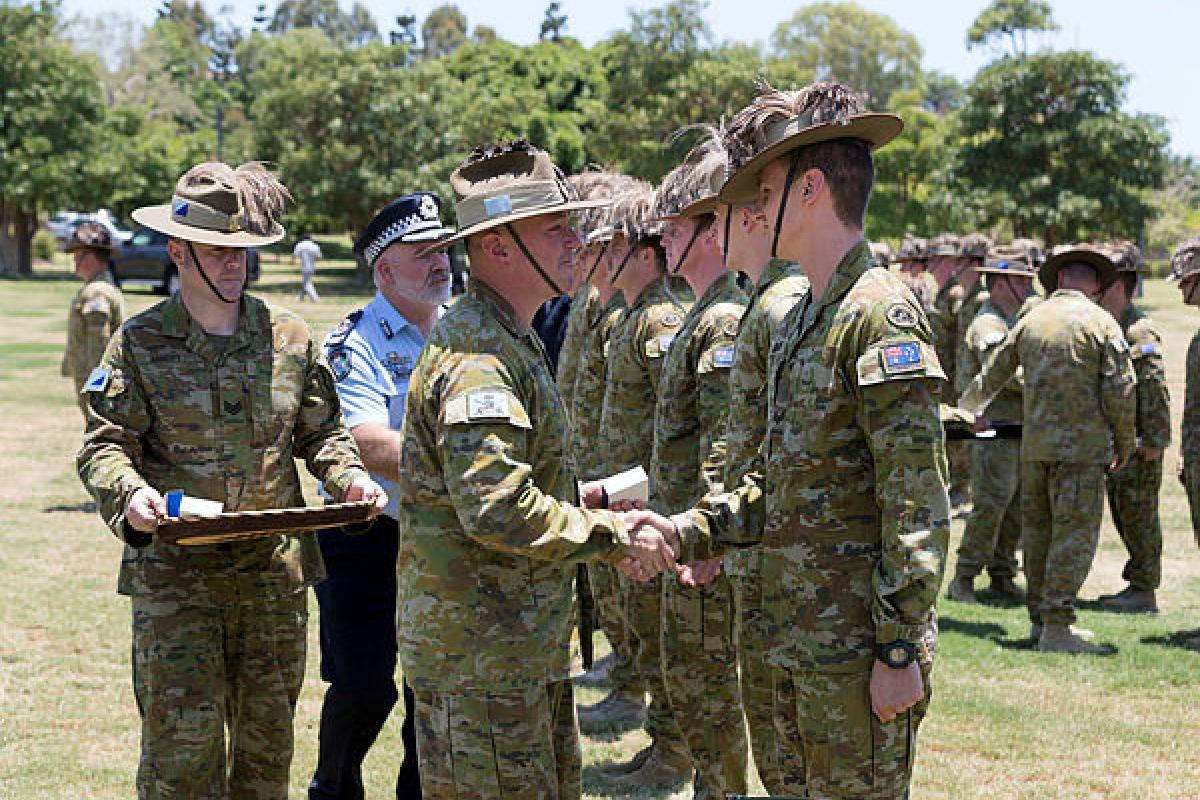 Commander of the 3rd Brigade, Brigadier Scott Winter, presents a commendation to Corporal Mathew Inskip from the 2nd Cavalry Regiment during a parade at Jezzine Barracks, Townsville. Photo: Trooper Jarrod McAneney