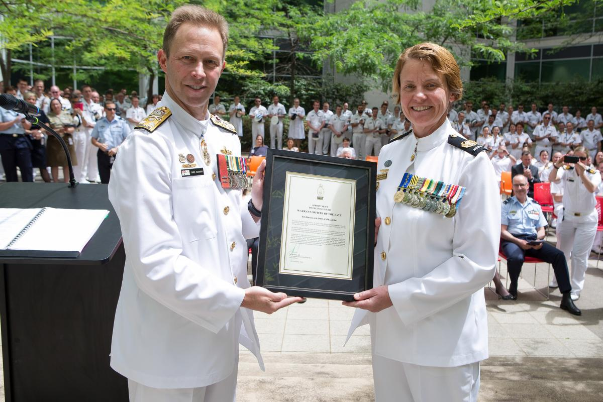 Chief of Navy Vice Admiral Mike Noonan presents Warrant Officer Deb Butterworth with her promotion certificate as the newly appointed WO-N during a ceremony at Russell Offices. Photo: Leading Seaman James McDougall