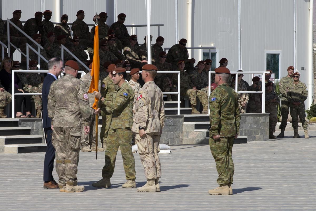 Major General Simon Stuart hands over the MFO flag to Director General MFO Ambassador Stephen Beecroft during the change of command parade in Sinai, Eygpt. Photo: Captain Jarrad Baldwin