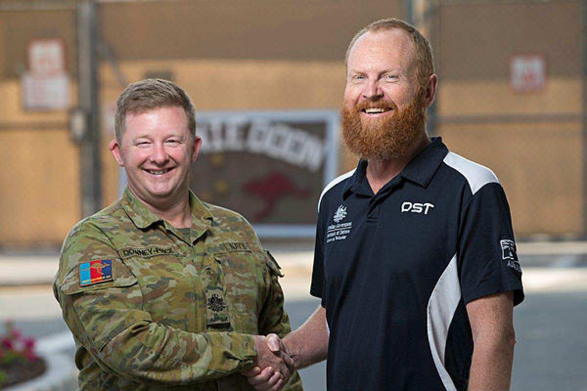 Royal Australian Navy Warrant Officer Justin Downey-Price, left, and operations analyst Jeffrey Seers together on operations in the Middle East Region. Photo: Sergeant Kirk Peacock