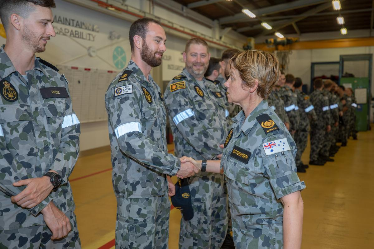 Shaking hands with Leading Seaman Nathan Spilling, Warrant Officer of the Navy Deb Butterworth thanks the members of Fleet Support Unit-East for their efforts. Photo: Leading Seaman Chris Szumlanski