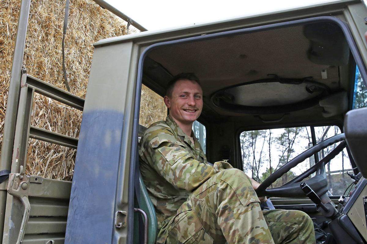 Army Reserve soldier Private Jonathan Catt, a Unimog truck driver with 16 Transport Squadron, from Newcastle, took part in a fodder delivery to farmers at Mogo and Cobargo.