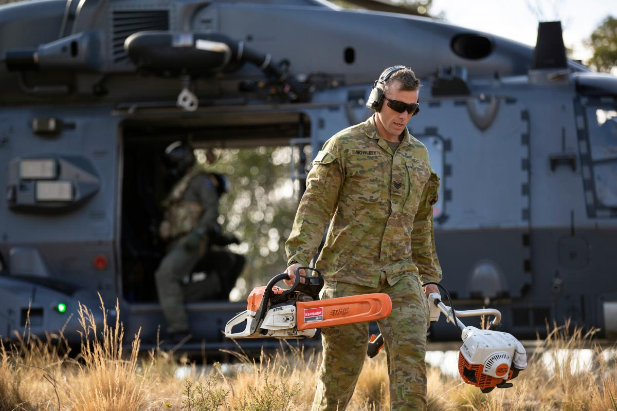 Sergeant Joshua Howlett, of 7RAR, disembarks a Royal New Zealand Air Force NH90 to conduct land clearing and fuel reduction on Brindabella Mountain, west of Canberra. Photo: Signaller Robert Whitmore