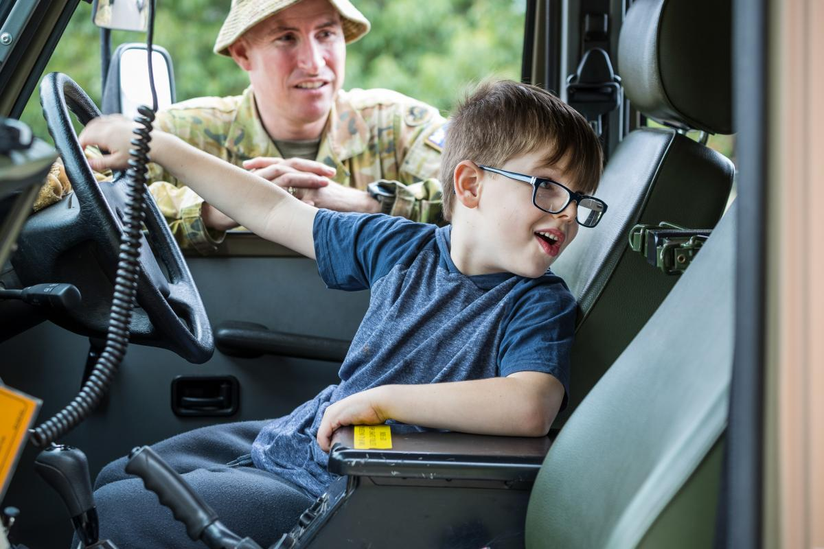 Regimental Sergeant Major 5th/6th Battalion, Royal Victorian Regiment, Warrant Officer Class One Anthony Jones watches as Omeo local Ryan checks out the inside of a G-Wagon. Photo: Corporal Sebastian Beurich