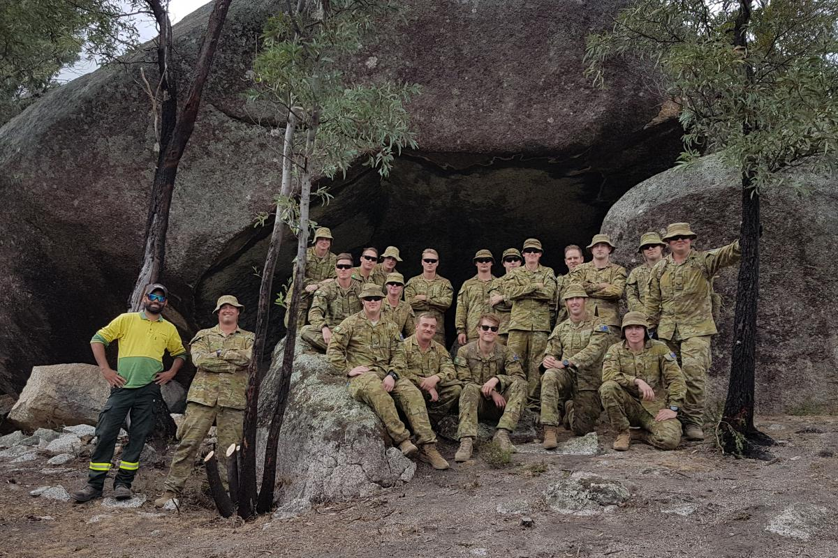 Soldiers from the Royal Australian Regiment 6th Battalion with ACT Parks and Conservation Service Aboriginal field officer Kie Barratt. Photo: Lieutenant Jack Membrey
