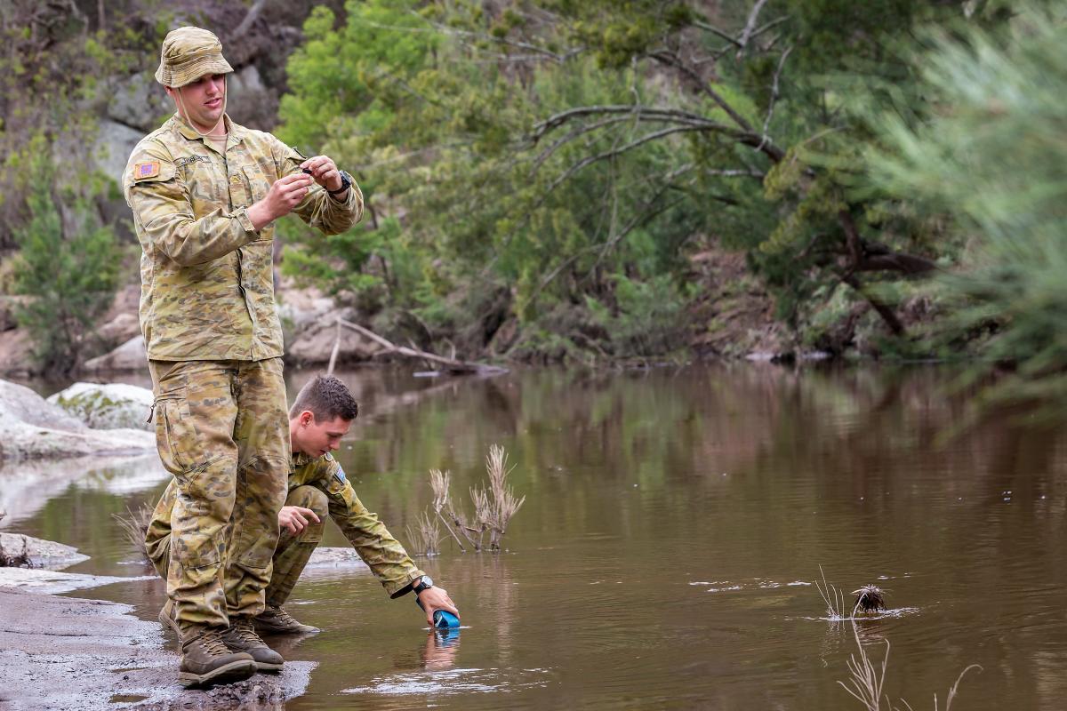 Lance Corporal Mitchell Thoresen and Craftsman Todd Kitching test water from the Brogo River. Photo: Corporal Dan Pinhorn