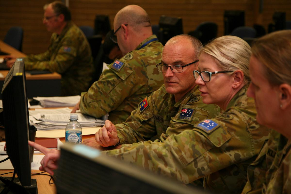 Sergeant Warwick Harvey, of the Army Compliance & Assurance Unit, and Corporal Di Murray, of 4/19 Prince of Wales Light Horse, scrutinise personnel data during the audit. Photo: Major Cameron Jamieson