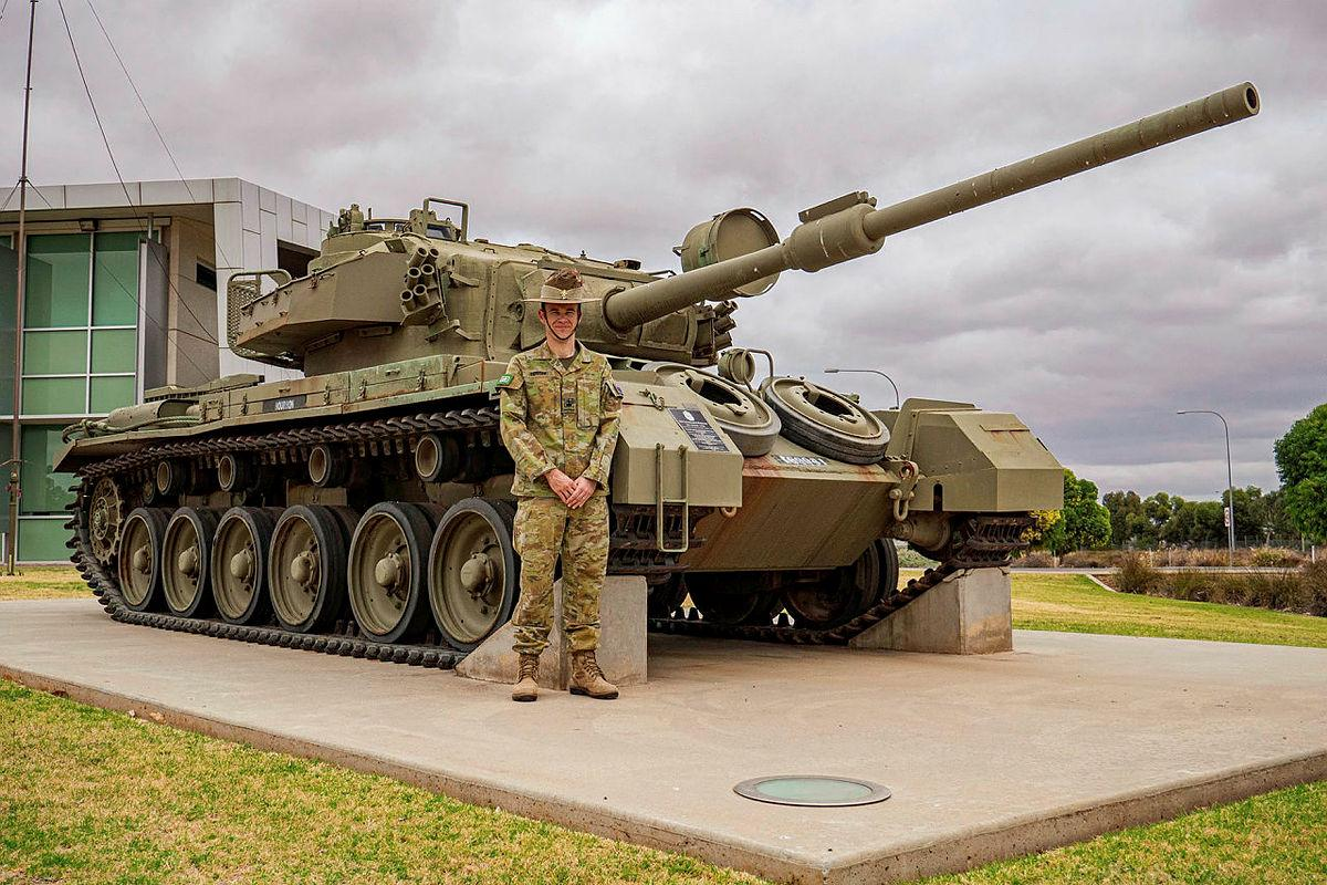 Warrant Officer Class 2 Michael Foster stands in front of a retired Australian Army Centurion Tank used in Vietnam. Photo: Private Luke Jones