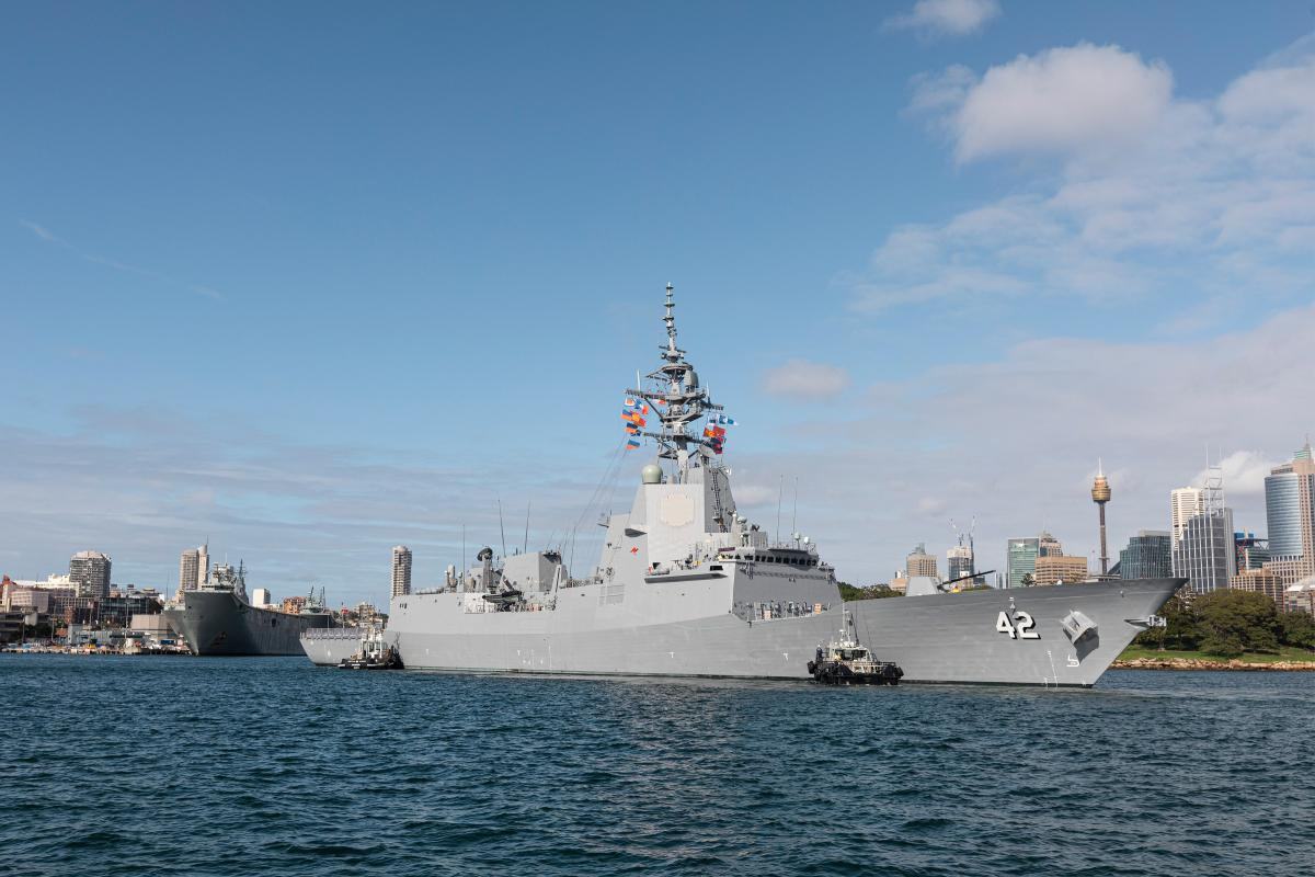 NUSHIP Sydney comes alongside Garden Island  in her home port for the first time. Photo: Private Olivia Cameron