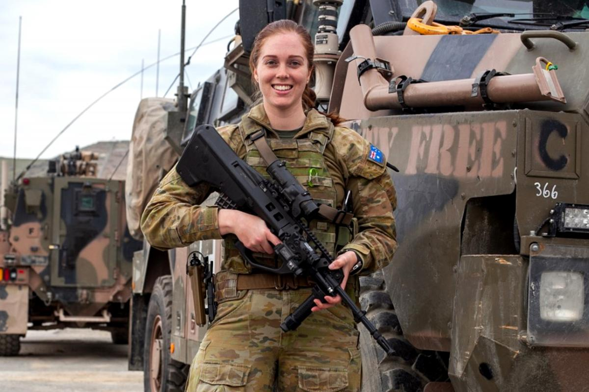 Private Meagan Crookson in front of protected mobility vehicles in Kabul, Afghanistan.