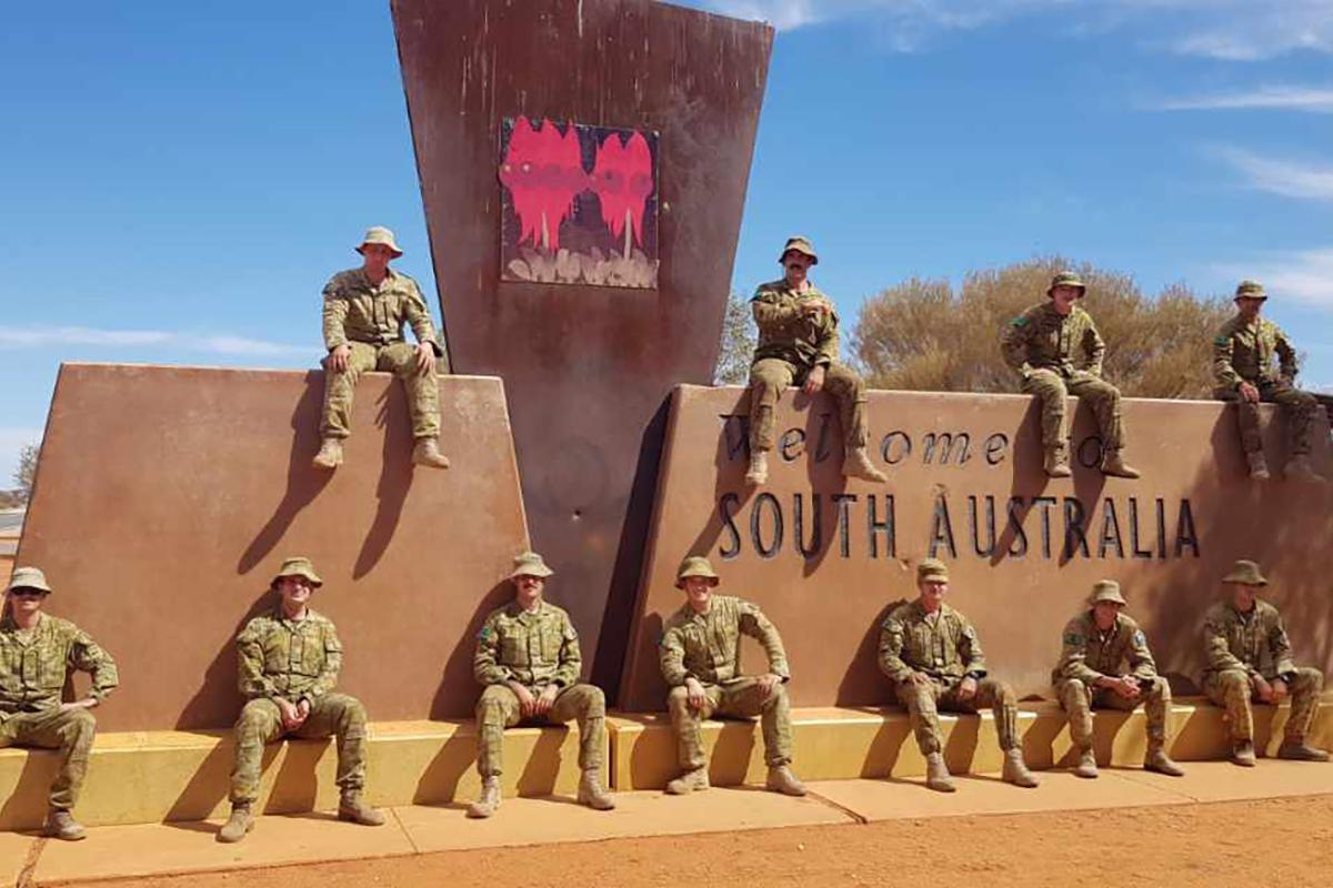 Soldiers of 1st Combat Service Support Battalion at a Northern Territory Police border control point between the Northern Territory and South Australia at Kulgera.