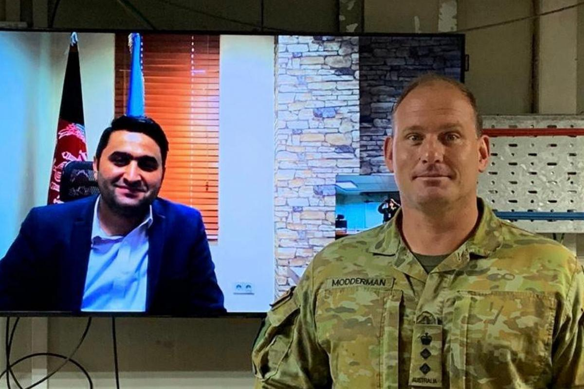 Colonel Eric Modderman conducts a video conference call with the Afghan Deputy Minister of Interior as part of the Advise, Train and Assist mission in Afghanistan.