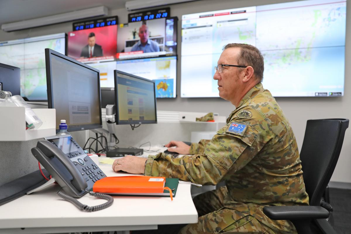 Warrant Officer Class One Andrew Gehrig working at the State Control Centre, Victoria. Photo: Petty Officer Nina Fogliani
