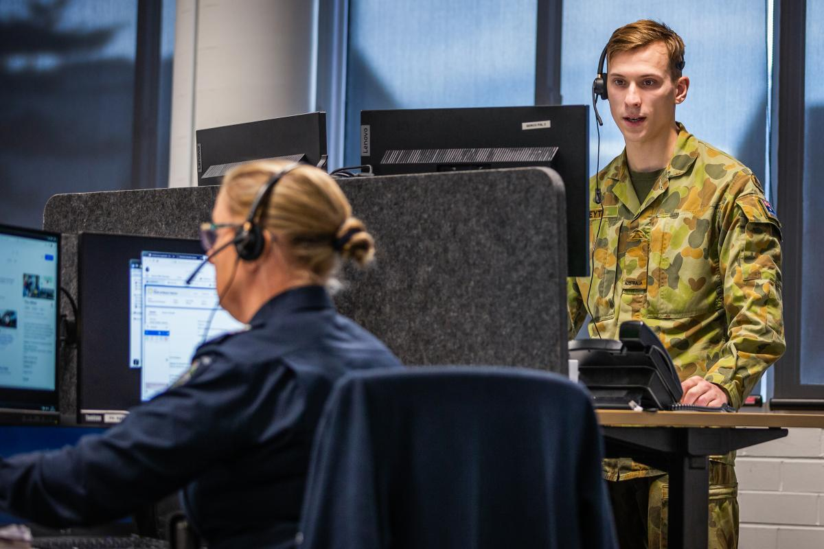 Private James Keyte responds to incoming reports on the Police Assistance Line in Ballarat, Victoria, in support of Operation COVID-19 Assist. Photo: Leading Aircraftman John Solomon