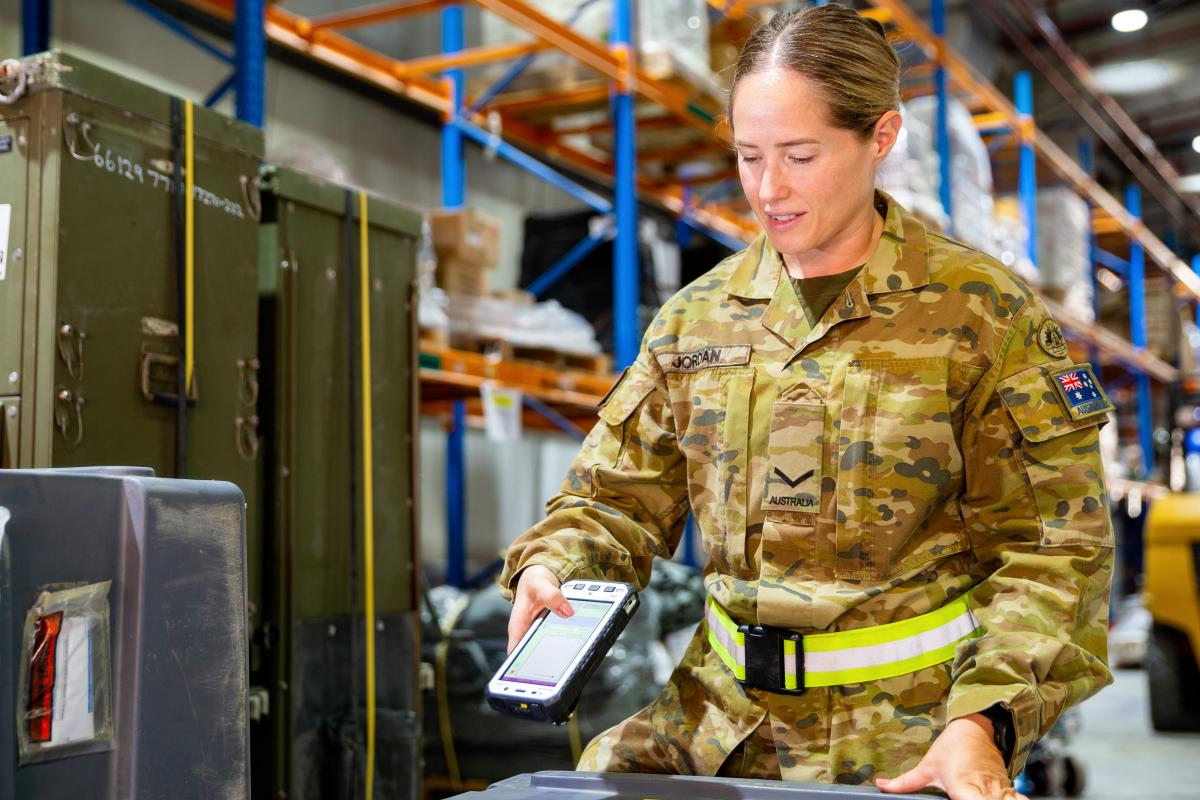Lance Corporal Rachel Jordan checks cargo at the main warehouse at Australia's Main Operating Base in the Middle East. Photographer: Petty Officer Yuri Ramsey