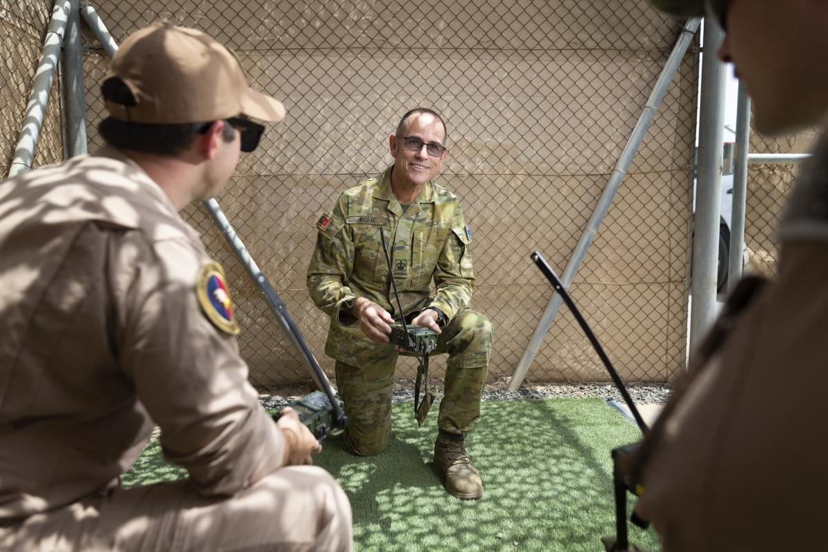 Joint personnel recovery officer Warrant Officer Class 2 Clive Keam conducts radio training with pilots while deployed on Operation Accordion in the Middle East Region. Photo: Corporal Tristan Kennedy