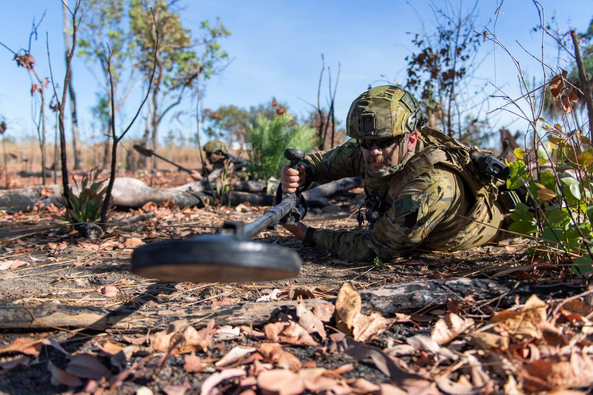 Sapper Lewis Coulter sweeps for mines during the 1st Combat Engineer Regiment Commanding Officers' Challenge held at Robertson Barracks, Northern Territory. Photo: Private Rodrigo Villablanca