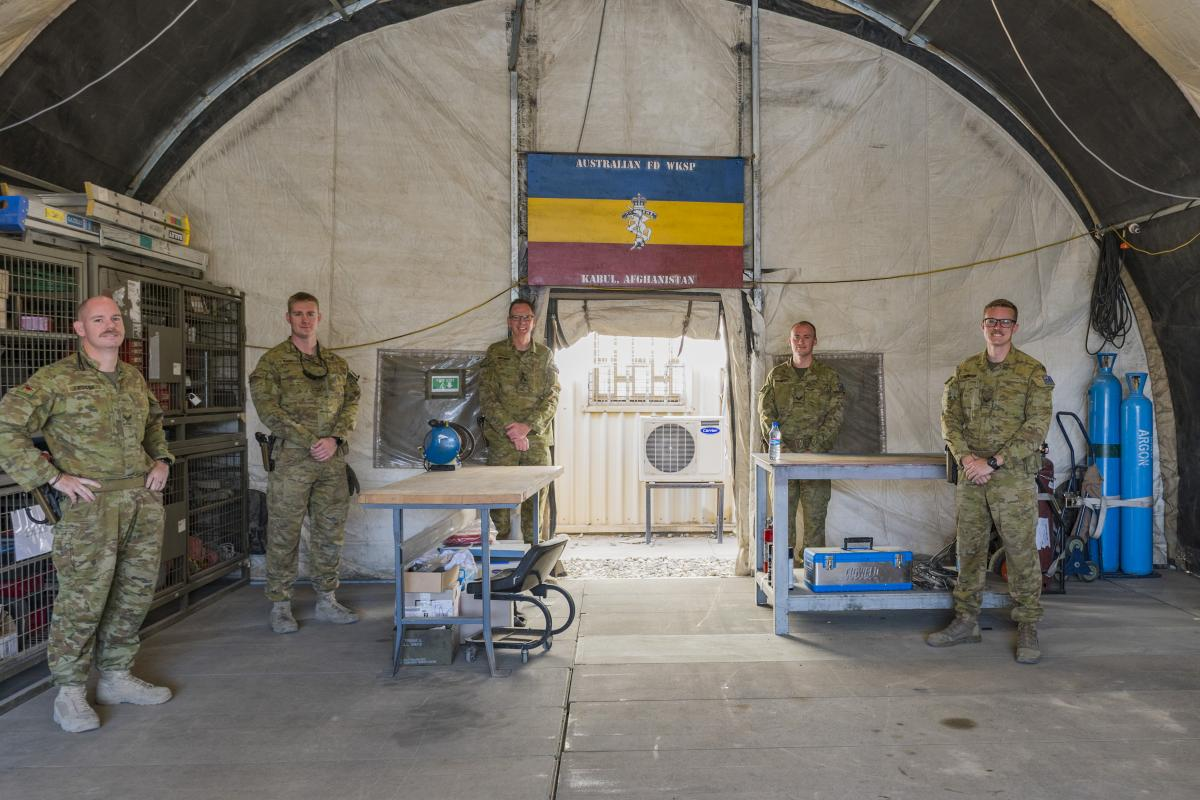 Commander Task Group Afghanistan Brigadier Ed Smeaton, centre left, opens a deployable field workshop along with fellow REAME Corps members at Hamid Karzai International Airport in Kabul Afghanistan.