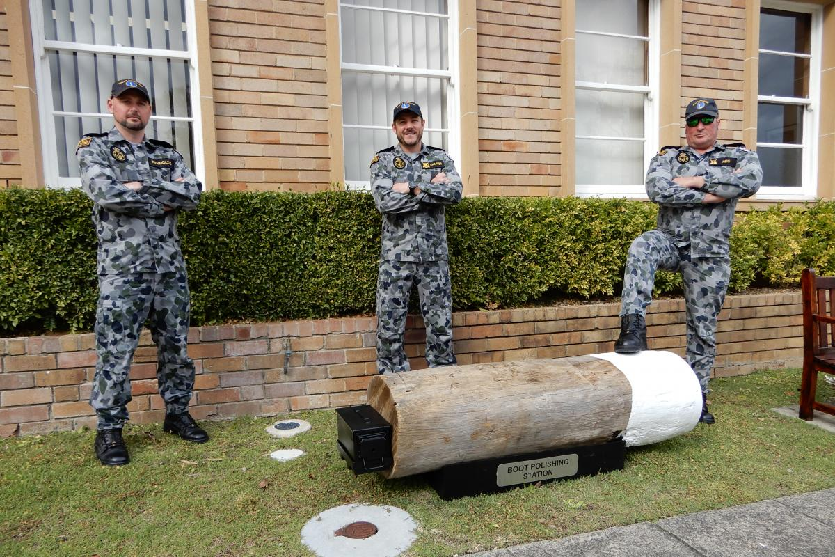 Petty Officer Boatswain Brendon Chafer, left, Leading Seaman Boatswains Mate Steven Reig and Leading Seaman Boatswains Mate Bradley Reynolds with one of the boot-cleaning stations at HMAS Penguin. Photo: Lieutenant Anthony Martin