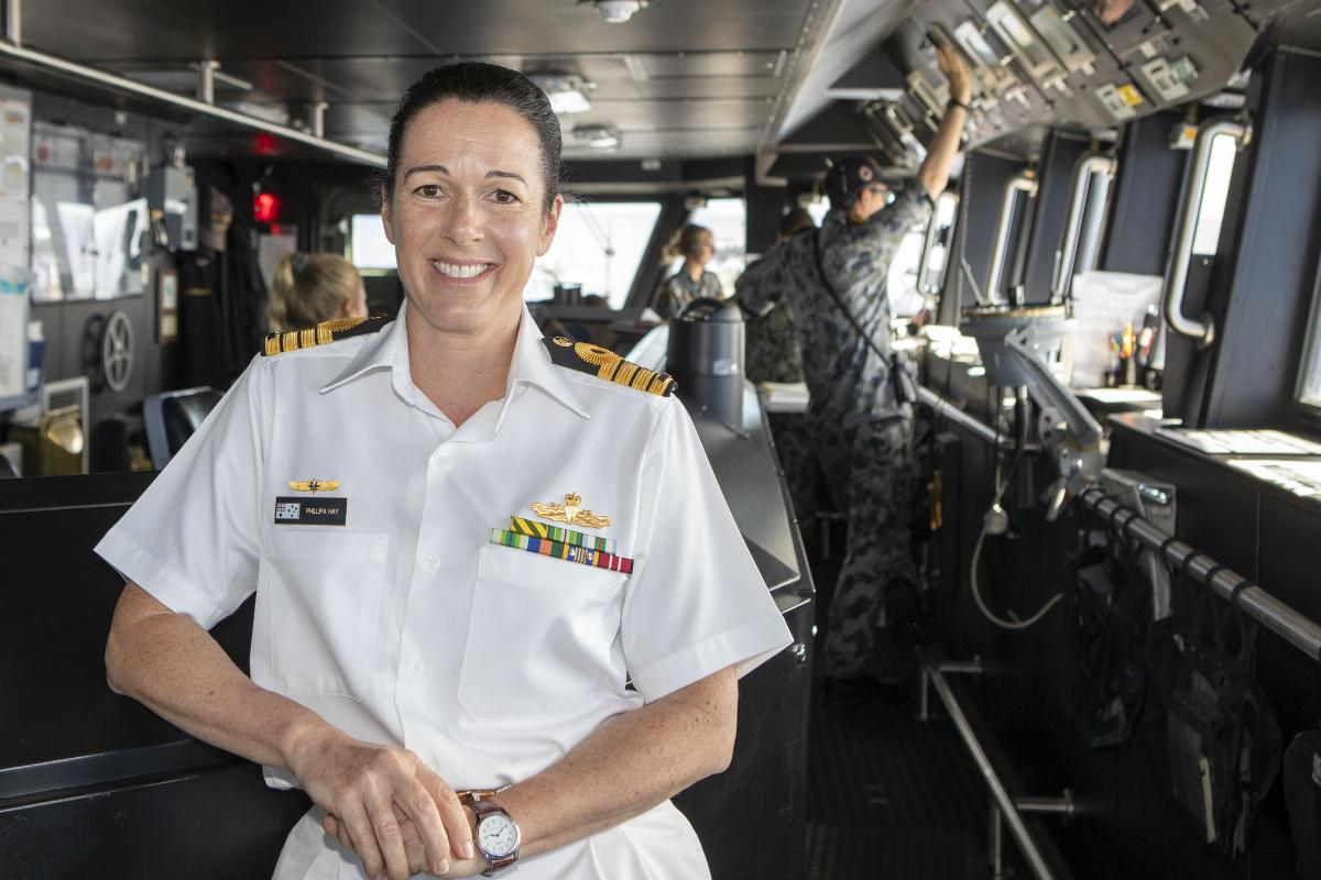 Captain Phillipa Hay, on the bridge of HMAS Hobart, is the first non-US military woman to lead a task force in the 49-year history of Exercise Rim of the Pacific. Photo: Leading Seaman Ernesto Sanchez