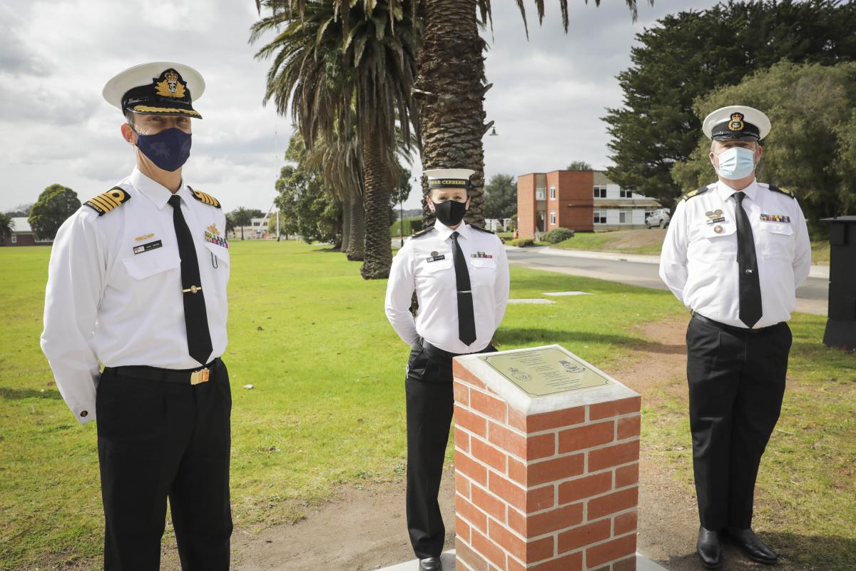 Commanding Officer HMAS Cerberus Captain Mike Oborn, Leading Seaman Jodi Farmer and HMAS Cerberus Command Warrant Officer Michael Connors with the commemorative plinth marking 100 years of service. Photo: Leading Seaman Bonny Gassner
