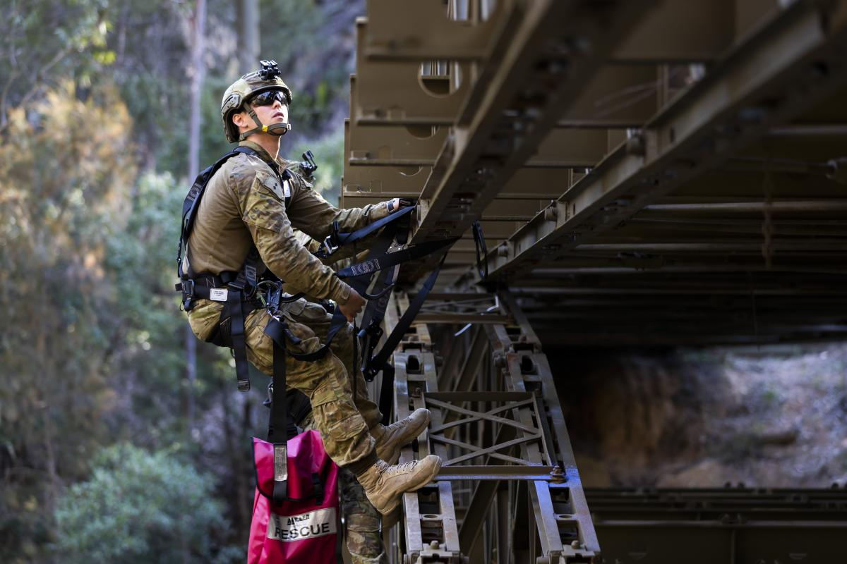 Lieutenant James Bonney attaches simulated explosives to a bridge during the final field phase of the Engineer Regimental Officer Basic Course. Photo: Sergeant Ray Vance