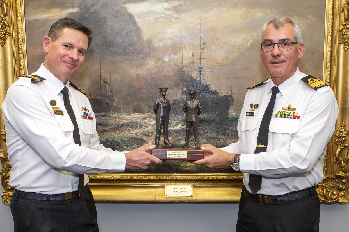 Rear Admiral Mark Hammond hands over 'the weight' of command to newly appointed Deputy Chief of Navy Rear Admiral Christopher Smith at a ceremony at Navy Headquarters in Canberra. Photo: Leading Seaman James McDougall