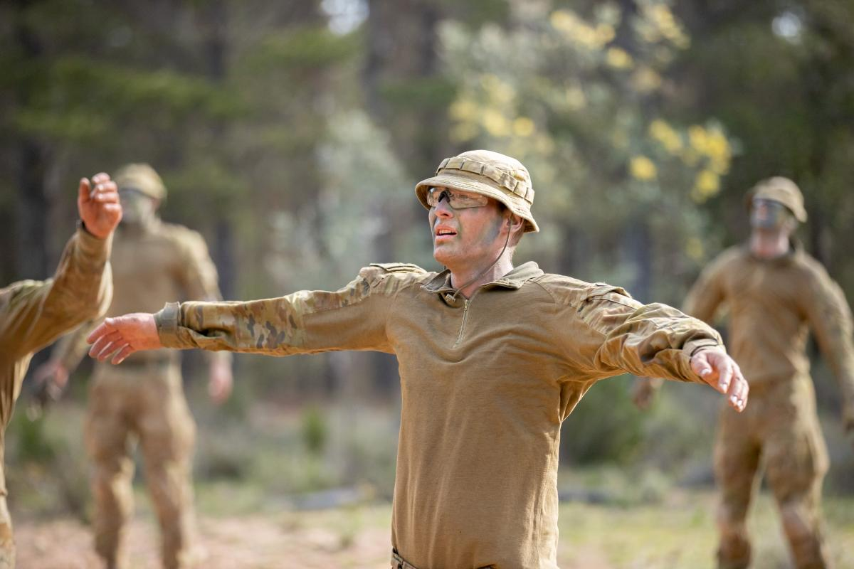 Staff Cadet Nathan Gould conducts star-jumps during a PT session on Exercise Shaggy Ridge at Majura Training Area in Canberra, ACT. Photo: Corporal Robert Whitmore